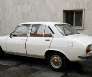 Iranian President Mahmoud Ahmadinejad�s 1977 Peugeot 504 has received a one million d...