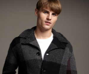 This Burberry Brit jacket sports an updated check pattern in two colors, and incorpor...