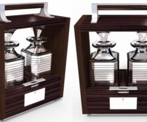 The Tantalus in a lockable Macassar ebony and dark stained walnut case comes with nic...