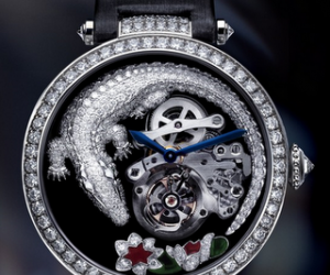 The Crocodile on the black dial is curled around, almost protecting, a flying tourbil...