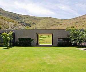 Contemporary architecture and the beauty of the South African countryside are seamles...