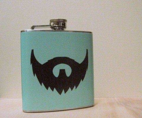 A perfect gift for the man drunk on facial hair, this 6oz Stainless Steel Flask has a traditional screw on cap, extra glossy varnish for durability, and comes in several colorways ranging from 'blush' to 'curry'.   With a body measuring at 4.5″ x 3.58″ inches,  it's small enough for any groom to sneak in and big enough to get buzzed before tying the knot.